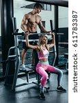 fitness instructor exercising... | Shutterstock . vector #611783387