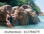 female in swimwear posing in... | Shutterstock . vector #611786675
