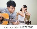 asian woman annoyed at a man... | Shutterstock . vector #611792105