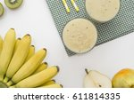 banana smoothie with kiwi and... | Shutterstock . vector #611814335