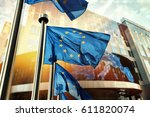 eu flags waving in front of... | Shutterstock . vector #611820074