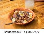 acai bowl with granola  bananas ... | Shutterstock . vector #611830979