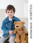 little boy sitting on the... | Shutterstock . vector #611857211