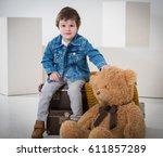 little boy sitting on the... | Shutterstock . vector #611857289