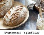 artisan rye sourdough bread in... | Shutterstock . vector #611858639
