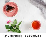 chocolate cake and tea on a... | Shutterstock . vector #611888255