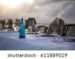 beach front dinner | Shutterstock . vector #611889029