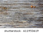 Small photo of A texture on a surface of old afzelia wood show a detail of cracked, scar, dust.