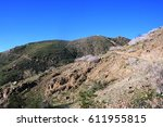 hiking trail leading up a hill... | Shutterstock . vector #611955815