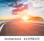 asphalt road and modern... | Shutterstock . vector #611958125