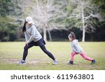 mother and daughter warming | Shutterstock . vector #611963801