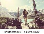 hiking man in canadian... | Shutterstock . vector #611964839