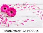 pink gerber on white wooden... | Shutterstock . vector #611970215
