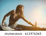 Stock photo healthy sports lifestyle athletic young woman in sports dress doing fitness exercise fitness 611976365