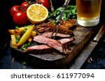 Steak with herbs and beer on a...