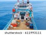 offshore worker handling an... | Shutterstock . vector #611993111