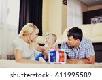 the young loving parents play...   Shutterstock . vector #611995589