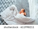 top view of 10 day old newborn... | Shutterstock . vector #611998211