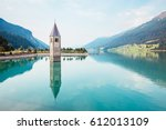 the old bell tower of curon... | Shutterstock . vector #612013109