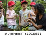 teacher and kids school... | Shutterstock . vector #612020891