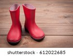 kid's rain shoes. red color.... | Shutterstock . vector #612022685