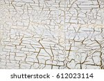 craquelure on gold with white... | Shutterstock . vector #612023114