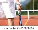 tennis player with racket... | Shutterstock . vector #612038759