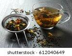 brewed delicious herbal tea on... | Shutterstock . vector #612040649