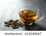 brewed delicious herbal tea on... | Shutterstock . vector #612040667