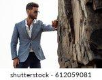 man in elegant suite posing in...   Shutterstock . vector #612059081