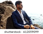man in elegant suite posing in... | Shutterstock . vector #612059099