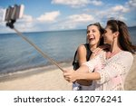 friendly selfie on beach | Shutterstock . vector #612076241