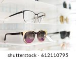 sunglasses and eye glasses in a ... | Shutterstock . vector #612110795