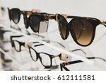 sunglasses and eye glasses in a ... | Shutterstock . vector #612111581