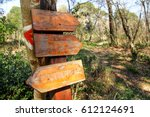 a signpost by the roadside in... | Shutterstock . vector #612124691