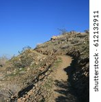 hiking trail leading up a hill... | Shutterstock . vector #612132911
