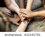 diverse hands are join together ... | Shutterstock . vector #612141731