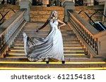 beautiful girl in a white dress ... | Shutterstock . vector #612154181