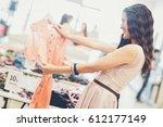 smiling caucasian woman buying... | Shutterstock . vector #612177149