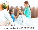 smiling girl and nurse holding... | Shutterstock . vector #612229721
