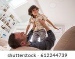 cheerful young boy having fun... | Shutterstock . vector #612244739