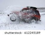red car suv breaks snowdrift ...