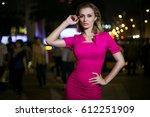 beautiful girl in a pink dress... | Shutterstock . vector #612251909