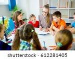 interesting lesson at school | Shutterstock . vector #612281405