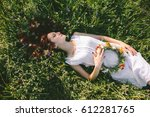 in spring  a young red haired... | Shutterstock . vector #612281765
