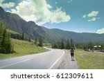 girl tourist with a backpack... | Shutterstock . vector #612309611