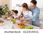 pleasant loving father giving... | Shutterstock . vector #612314411