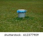 waste bin on meadow | Shutterstock . vector #612377909