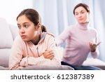 young mother reprimands her...   Shutterstock . vector #612387389