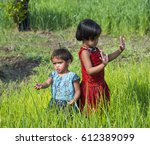 portrait of two happy adorable... | Shutterstock . vector #612389099